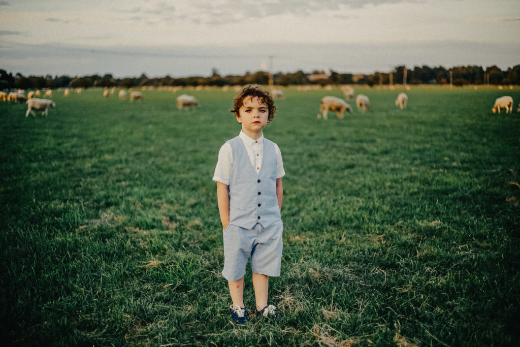 Portrait of a little boy in a sheep field, Stony Stratford, Milton Keynes, Buckinghamshire